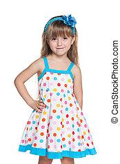 Small girl in polka dot dress