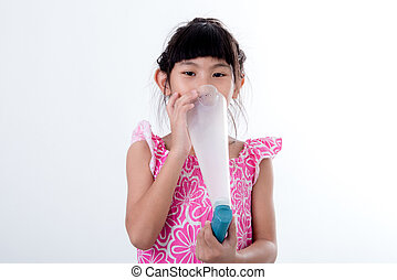 Small girl inhaling medicine