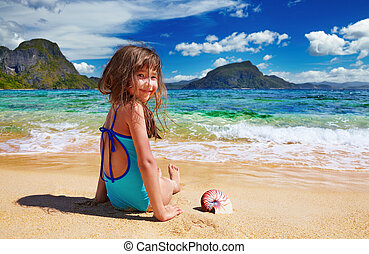 Small girl on the tropical beach
