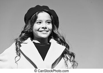 small girl outdoor. french style fashion. true parisian. kid fashion. stylish girl child after hairdresser. she has unreal curly hair. trip to france. lucky with weather. happy little lady. No rush