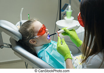small girl patient at the dentist