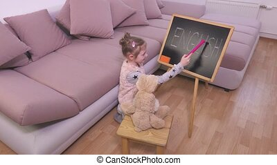 Small girl playing in teachers