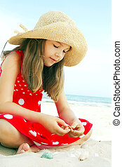 small girl playing on beach