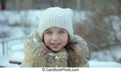 Small girl snowfall slow motion