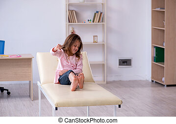 Small girl waiting for doctor in the clinic