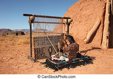 Small Girl Weaving Blanket - Image of a young Native...