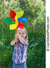 Small girl with a rainbow coloured windmill