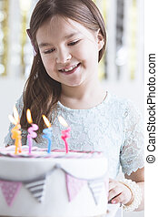 Small girl with birthday cake