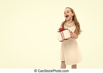 Small girl with gift box with red bow in dress.