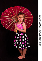 Small girl with pink umbrella