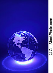 Small glass globe is illuminated by blue light from below;...