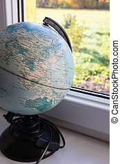 Small globe on the window