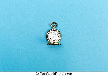 Small golden watch