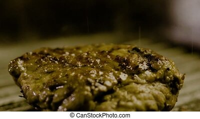 Small Grains Of Salt Fall On Steak Meat - Close-up - Small...