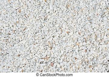 Small gravel stones, little scree texture macadam background...