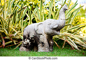 Small Gray Stone Statue of an Elephant in the Garden