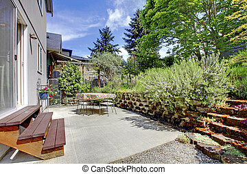 Small green fenced back yard with garden and shed