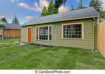 Small green guest house in the fenced backyard. - Small...