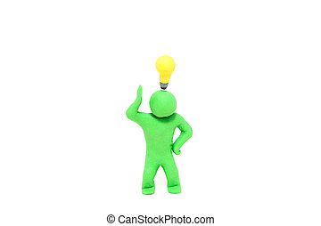 small green plasticine puppet with a electric bulb over the head