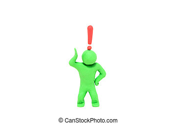 small green plasticine puppet with a exclamation mark over the head