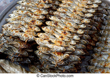 Small grilled fish at the market