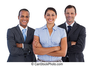Small group of smiling business people standing together on ...