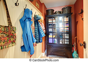 Small hallway with a rustic cabinet - Small hallway with an ...