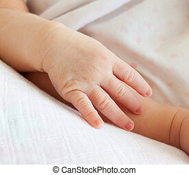 Small hand of newborn