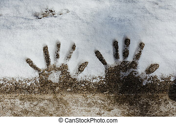 small handprints in the snow