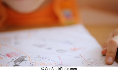 Small hands draw picture with marker