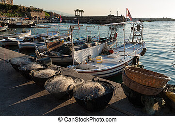 Fishing nets and boats at the harbor of Byblos, Lebanon, at sunset