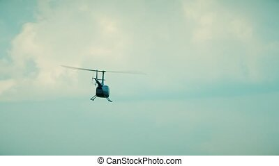 Small helicopter take off from the airport - A small...
