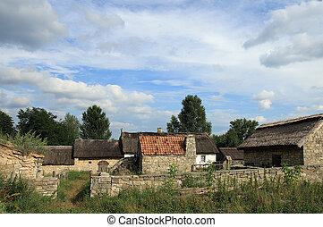 Small historical farmstead with stone buildings (preceding century, museum of Ukrainian folk architecture in Pirogovo village (near Kiev))