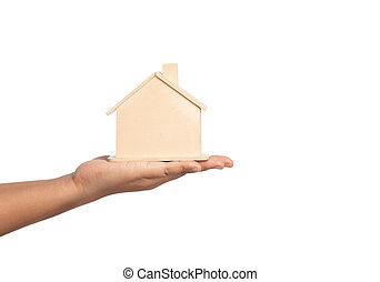 Small home model on the hand of women isolated on white background