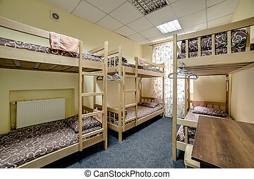 Small hostel room with two-level bunk beds
