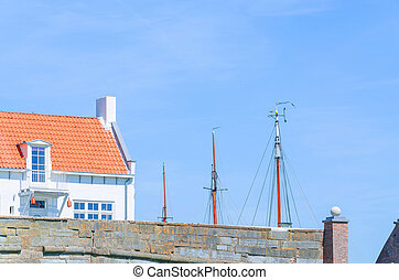 Small house at a harbor - Typical captain house on a small...