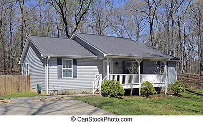 Small House Front Porch - A small house with vinyl siding...