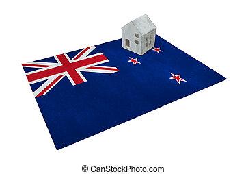 Small house on a flag - New Zealand