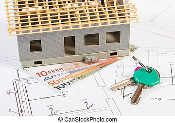 Small house under construction, keys and currencies euro on electrical drawings for project, building home cost concept