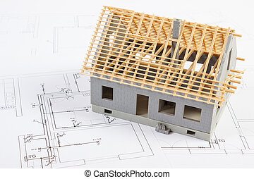 Small house under construction on electrical drawings, concept of building home