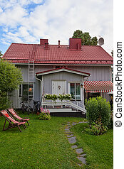 small house with a tiled roof