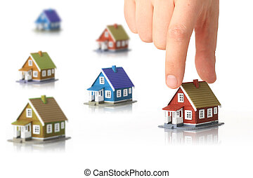 Small houses and hand isolated over white background.