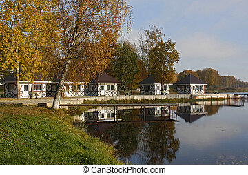 small houses and pier on lake