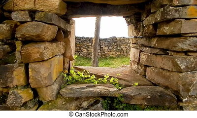 Small hut window in Peru leading to tree in center - closeup...