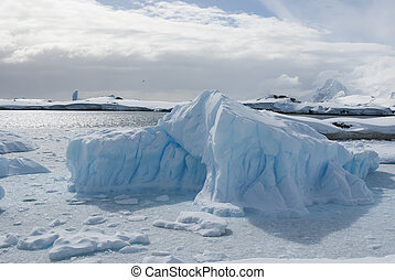 small iceberg in the Strait between the islands off the west coast of the Antarctic Peninsula