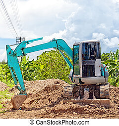 Small industrial digger - A small industrial digger moves...