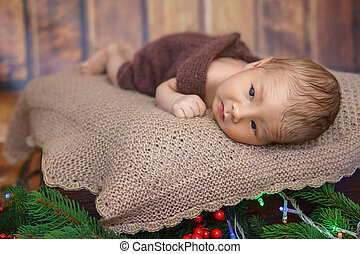 small infant boy lying on the surface