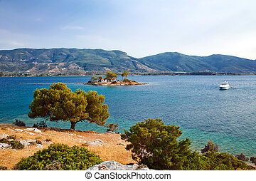 Small island in Aegean sea near Poros, Greece