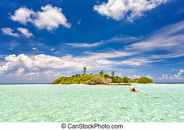 Small island in ocean on Maldives