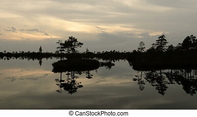 Small island in the pond. Autumn sunset. Smooth dolly shot